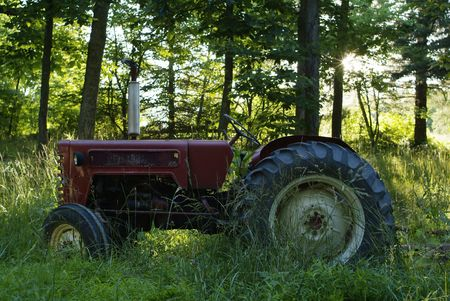 traction: tractor in the field with trees behind