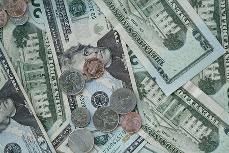 twenty dollar bills with random coins  photo