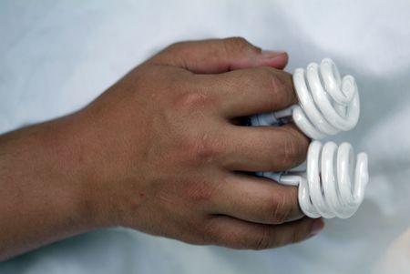 hand holding two energy saving light bulbs photo