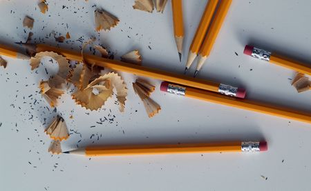 sharpened pencils scattered with pencil shavings