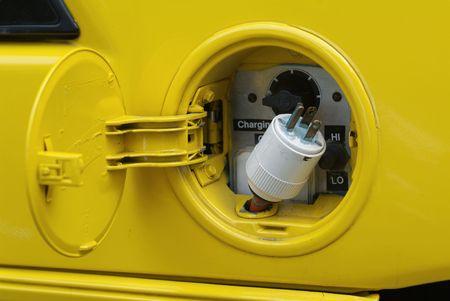 Cuando el tanque de gas es por lo general, hay un tap�n de color amarillo en este coche el�ctrico  Foto de archivo - 1298186