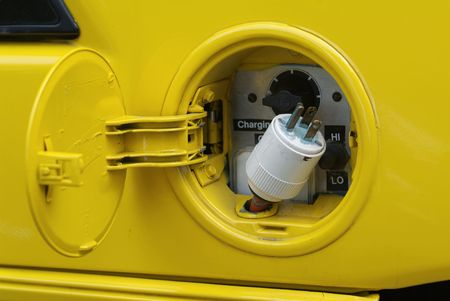 Where the gas tank is usually, there is a plug in this yellow electric car Stock Photo - 1298186