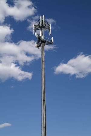 communication: cellular repeater tower with blue sky and clouds