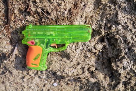 watergun: toy gun laying on the beach Stock Photo