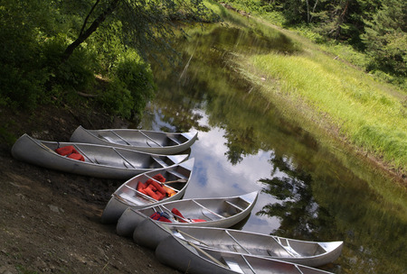 stoney: Six Canoes waiting on the shore of the river in the Adirondack Mountains on Stoney Creek