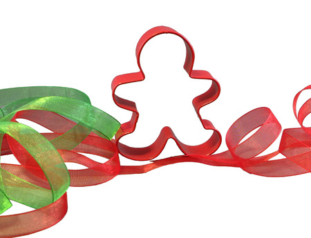 gingerbreadman: red cookie cutter with red and green ribbons