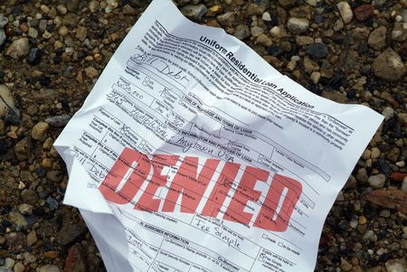 disapprove: A crumpled up home loan application (stamped with the word