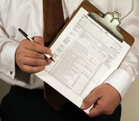 CPA Accountant holding a clipboard with a 1040 tax form ready to fill out.