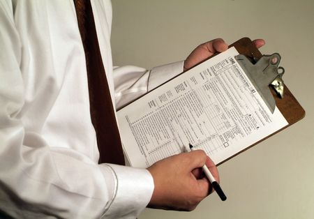 man in suit holding tax form Stock Photo