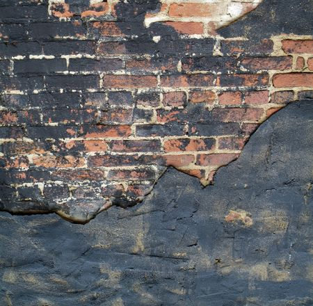 Textured brick background with black paint and stucco photo