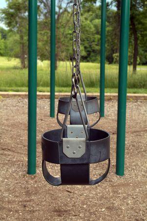 Empty childhood swing set Stock Photo - 3139303
