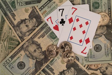 3 playing cards showing sevens with cash winnings surrounding.