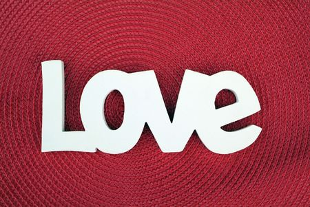 The word love on a red textured background