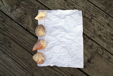 Rustic Notebook paper   with shells and wooden pattern behind Stock Photo - 3622059