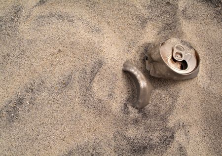 Discarded aluminum can in the sand Stock Photo