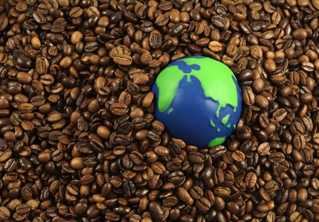 green bean: International coffee beans: green and blue globe surrounded by coffee beans