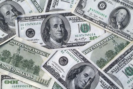Lots of cash- background pattern of one hundred dollar bills Stock Photo