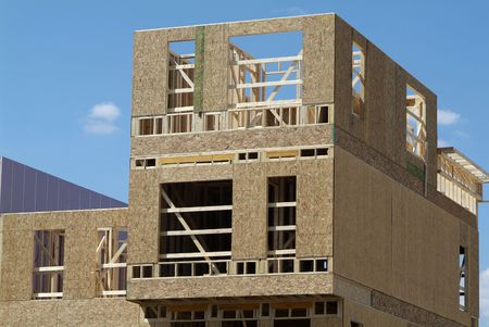 residential construction: Wood townhouse building under construction Stock Photo
