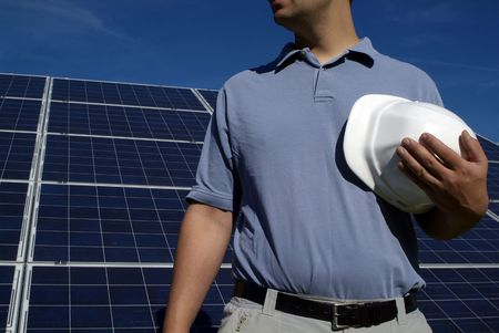 Eco friendly construction: construction worker with hard hat with solar panels