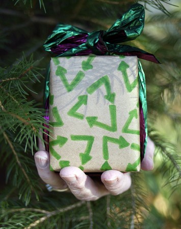 Christmas gift wrapped in recycled paper photo