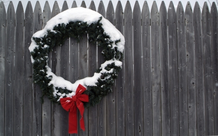 Christmas wreath on a fence  photo
