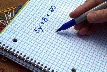 Person solving a Math linear equation problem  Stock Photo