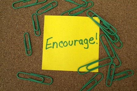 encouraged: Inspirational post it note with  Stock Photo