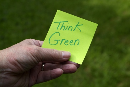 environmentalism: Green Eco Innovation sustainability concept: Person holding green sticky note with  Stock Photo