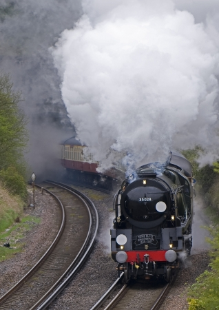 Vintage Steamtrain coming out of tunnel