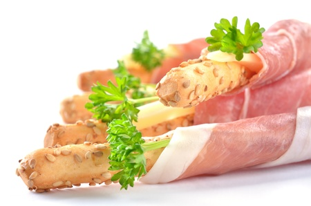 Grissini with prosciutto photo