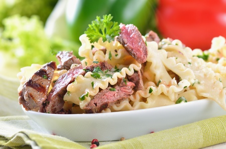 Pasta with grilled beef tenderloin photo