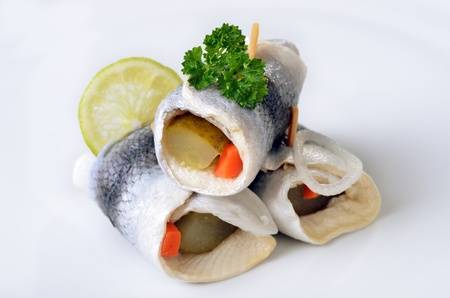 pickled: Three rollmops on white background Stock Photo