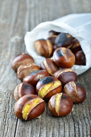 cornet: Roasted chestnuts in a white cornet Stock Photo