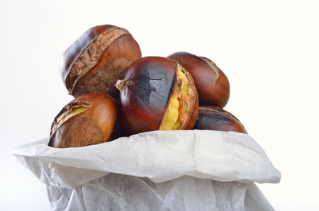 Roasted chestnuts in a white cornet photo