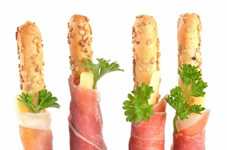Italian grissini with prosciutto from Parma and cheese sticks photo