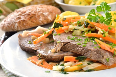 horse meat: Prime boiled beef with root vegetables and butter potatoes (Viennese Tafelspitz) Stock Photo