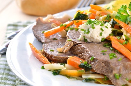Prime boiled beef with root vegetables and butter potatoes (Viennese Tafelspitz) Stock Photo