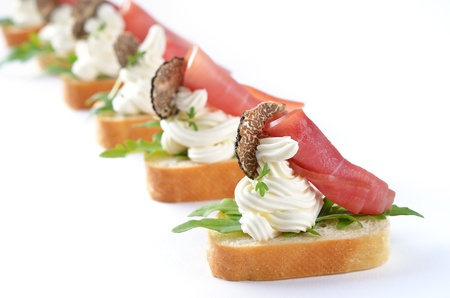 Deliciuos morsels with cream cheese, ham, rocket salad and Italian truffles Reklamní fotografie