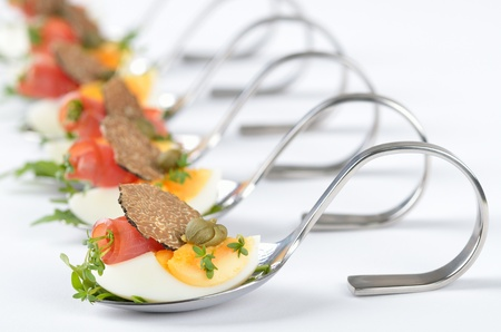 food buffet: Truffle appetizers with egg and ham on party spoons