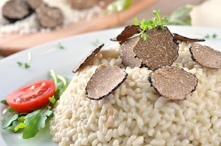 Risotto with fresh black Italian truffles photo