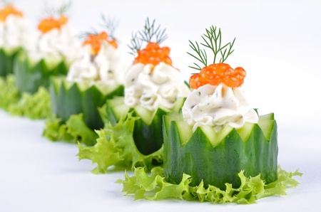 finger food: Fresh cream cheese with herbs and caviar on cucumber