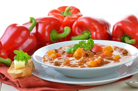 goulash: Typical Hungarian goulash soup with baguette