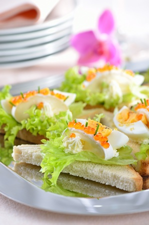 morsels: Delicious toast morsels with cheese (camembert), egg and trout caviar
