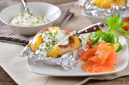stuffed fish: Jacket potato with sour cream and smoked salmon Stock Photo