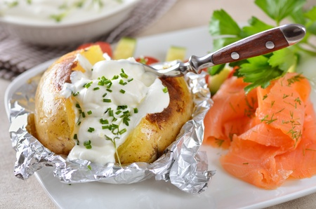 baked potato: Jacket potato with sour cream and smoked salmon Stock Photo