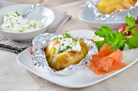 Jacket potato with sour cream and smoked salmon photo