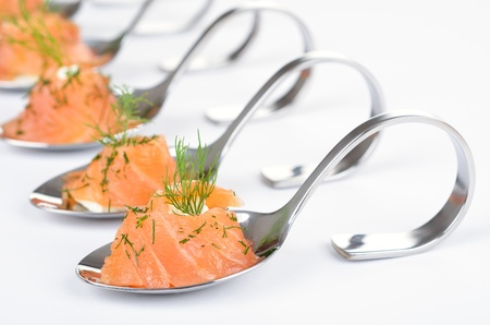 standing reception: Salmon appetizers on spoon Stock Photo