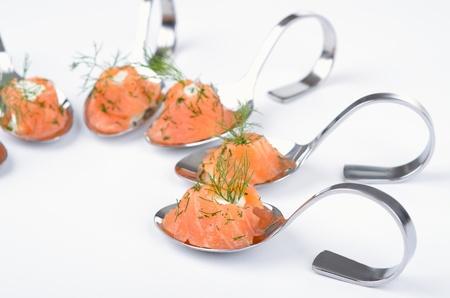 Salmon appetizers on spoon Reklamní fotografie