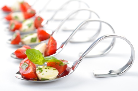 Tomato-Mozzarella on spoon photo