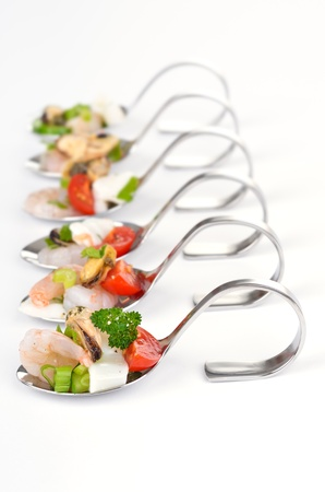 food buffet: Seafood salad on spoon